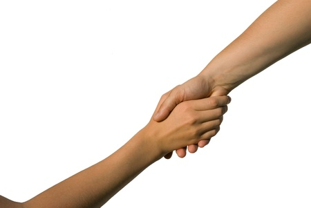 parship: two young hands, one helping another, on white