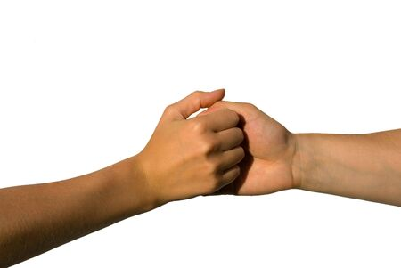 hesitation: two young hands holding each other, on white Stock Photo