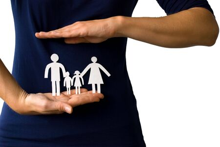 young hands protecting a paper chain family in front of a female body, on white Stock Photo - 17632128