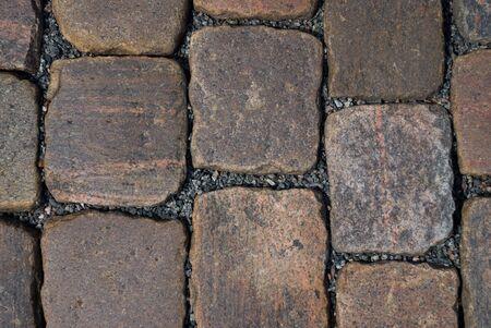 unyielding: cobblestone of granite stone as background
