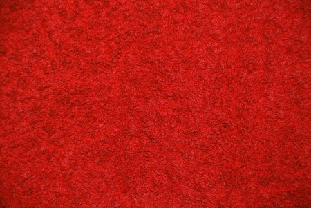 synthetic fiber: a red background with a structure of a towel