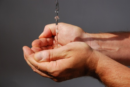hotness: two male hands absorbing clear water