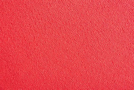 synthetic fiber: a red carpet structure as texture or background Stock Photo