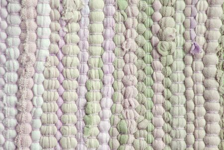 synthetic fiber: a green and purple background with a structure like a carpet or cloth material Stock Photo