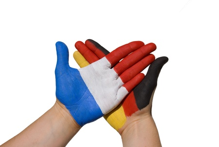 treaties: a handshake between france and germany Stock Photo