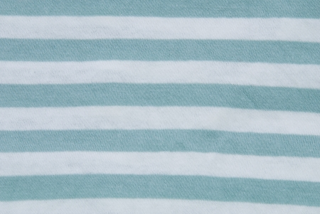 synthetic fiber: a texture with green and white stripes