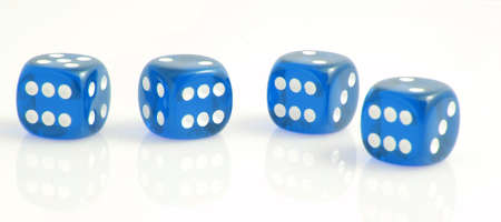 luckiness: four blue dice showing the number six, symbolizing luck Stock Photo