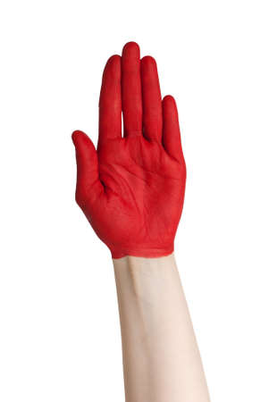 a red painted hand signalizing danger, risk or a colorful handshake Stock Photo - 18104050