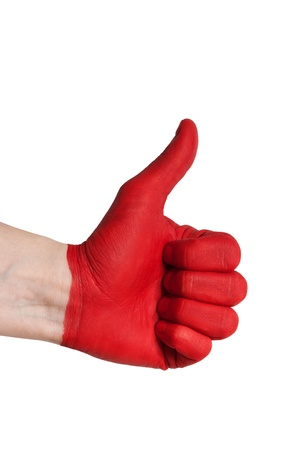 a red painted hand showing one thumb up, isolated Stock Photo - 18104077