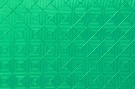synthetic fiber: a background or texture with light green rhombs