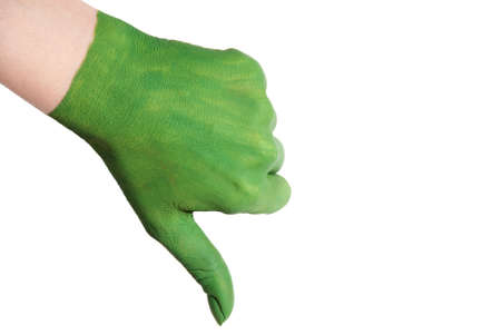 negatively: a green painted hand shows thumbs down