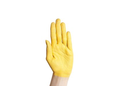 hold up: a yellow hand hold up in the air, isolated