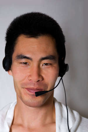 asian man with headset on white photo