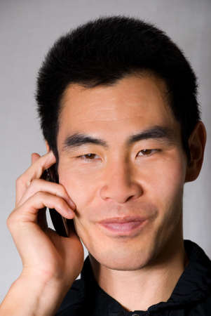 man talking on an mobile phone photo