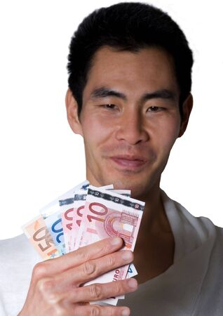 asian looking man holds european money in his hand photo