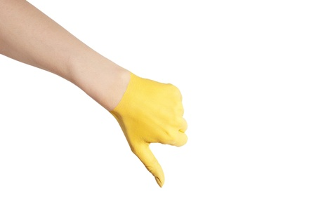 endangerment: a yellow painted hand showing one thumb down