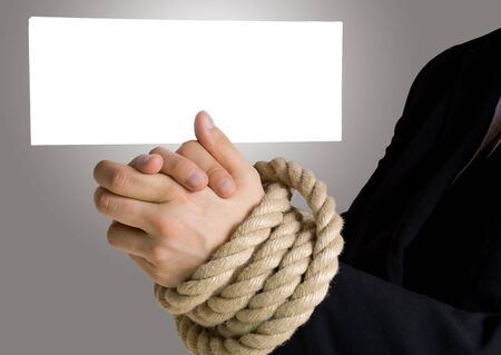 business hands in chains with white banner with copyspace on it photo
