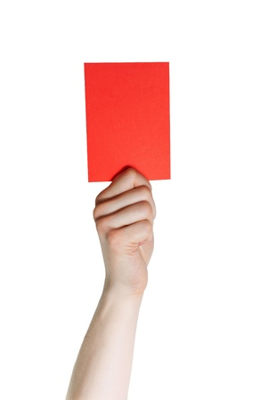 outrage: a hand holding a red card, isolated on white
