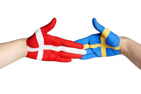 a handshake between sweden and denmark, isolated on white photo