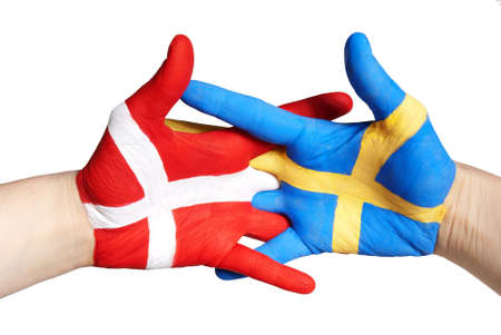 two painted hands handshaking in red, blue, white and yellow photo