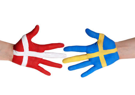 two hands painted in the colors of denmark and sweden, isolated Stock Photo - 18711212