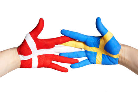 two hands painted in the colors of denmark and sweden shaking photo