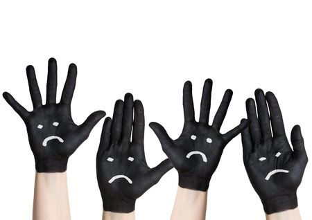 mistrust: sad or angry hands, painted black, isolated