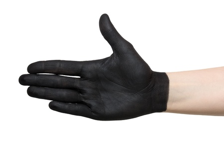 a black painted hand in handshake gesture photo