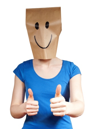 masquerading: a person with a mask and a winning smile, isolated Stock Photo