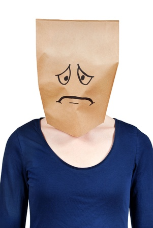 masquerading: a person with paper bag head symbolizing sadness and depression, isolated Stock Photo