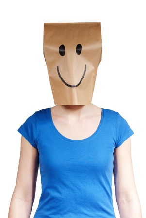 masquerading: a happy person with paper bag in front of head, isolated