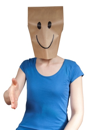 a happy paper bag person inviting to shaking hands, isolated photo