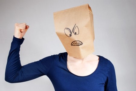 angriness: a angry person with bad smiley on paper bag head