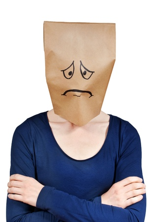 a very sad looking person with paper bag on its head, isolated photo