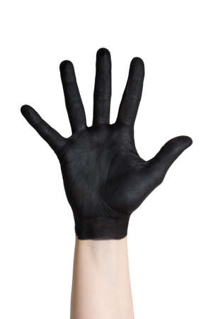 a black painted hand isolated on white photo