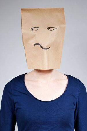 masquerading: a person thinking or looking critical or bored