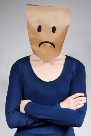a sad and depressed looking person on gray background