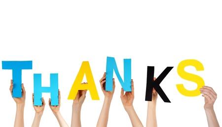 merci: mains tenant les lettres color�es de construction le mot MERCI, isol�s Banque d'images
