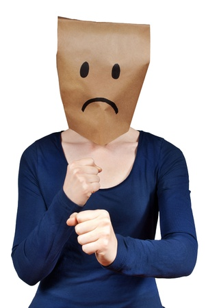 masquerading: a unhappy looking person symbolizing rage, isolated Stock Photo