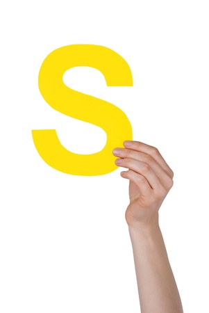 illiterate: the letter S, hold by a hand, isolated