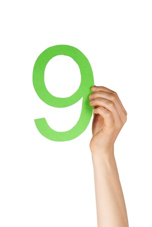 hand holdin up a green number nine, isolated Stock Photo - 19745636