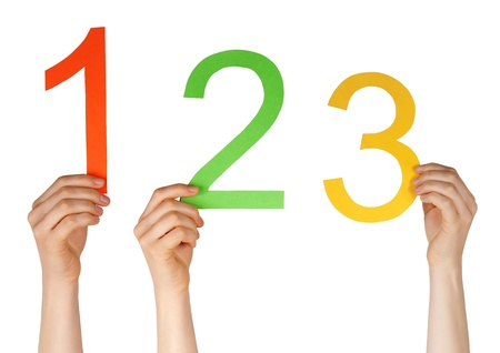 hands holding uo the numbers one, two, three, isolated Stock Photo - 19745642
