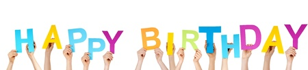 altogether: many hands holding the letters which are building the word HAPPY BIRTHDAY, isolated
