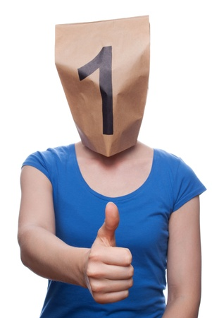 achievment: a person with a paper bag head showing a one, isolated Stock Photo