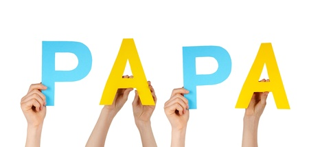 many hands holding the word papa, isolated on white photo