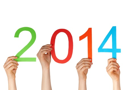 next year: some hands holding the numbers 2014, isolated Stock Photo