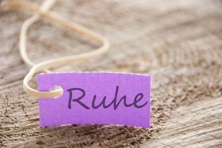 attachement: a purple banner on tree on which stands the german word Ruhe which means calmness