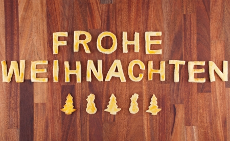 frohe: the german words Frohe Weihnachten, which means merry christmas with cookies Stock Photo