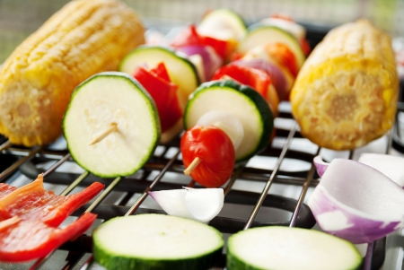 closeup of a vegetarian barbecue, corn and vegetable spits photo
