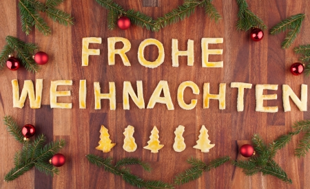 the german words Frohe Weihnachten which means merry christmas with christmas decorations photo
